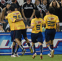 Monarcas Morelia defender Diego Martinez (4) celebrates with teammates after scoring the goal that tied the game in the 79th minute of play. Monarcas Morelia tied DC United 1-1 in the SuperLiga opening match in group B, at RFK Stadium in Washington DC, Wednesday July 25, 2007.