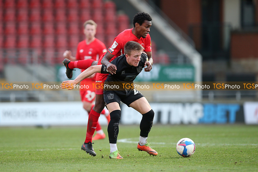 Alex Hurst of Port Vale and Tunji Akinola of Leyton Orient during Leyton Orient vs Port Vale, Sky Bet EFL League 2 Football at The Breyer Group Stadium on 20th February 2021
