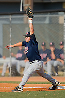 First baseman Brian Burke #9 of the Elizabethton Twins stretches for a throw against the Johnson City Cardinals at Howard Johnson Field July 3, 2010, in Johnson City, Tennessee.  Photo by Brian Westerholt / Four Seam Images
