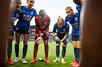 TACOMA, WA - JULY 31: OL Reign huddle together during a game between Racing Louisville FC and OL Reign at Cheney Stadium on July 31, 2021 in Tacoma, Washington.