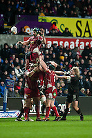Friday 03 January 2014<br /> Pictured:George Earle of the Scarlets goes for the ball during a line out <br /> Re: Ospreys v Scarlets, Rabo Direct Pro 12 match at the Liberty Stadium Swansea, Wales