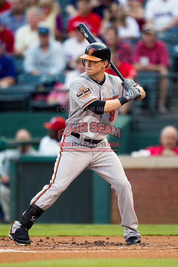 Baltimore Orioles outfielder Nate McClouth #9 at bat during the Major League Baseball game against the Texas Rangers on August 21st, 2012 at the Rangers Ballpark in Arlington, Texas. The Orioles defeated the Rangers 5-3. (Andrew Woolley/Four Seam Images).