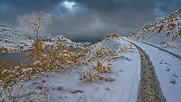 Fine Art Winter Scenic of the first snowfall on a secluded road overlooking Skaha Lake in BC, Canada.