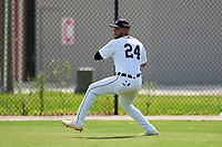 FCL Tigers West outfielder Roberto Campos (24) throws the ball in during a game against the FCL Yankees on July 31, 2021 at Tigertown in Lakeland, Florida.  (Mike Janes/Four Seam Images)
