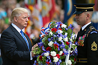 A soldier assists President Donald J. Trump with laying a wreath at the Tomb of the Unknowns in Arlington National Cemetery in Arlington, Va. May 29, 2017. (DoD photo by EJ Hersom)