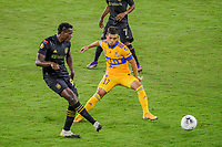 22nd December 2020, Orlando, Florida, USA;  LAFC Jesus Murillo  passes the ball away from Tigres Leonardo Fernandez during the Concacaf Championship between LAFC and Tigres UANL on December 22, 2020, at Exploria Stadium in Orlando, FL.