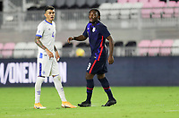 FORT LAUDERDALE, FL - DECEMBER 09: Ayo Akinola #9 of the United States and Ivan Mancia #4 of El Salvador during a game between El Salvador and USMNT at Inter Miami CF Stadium on December 09, 2020 in Fort Lauderdale, Florida.