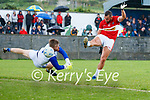 George Durrant scores his DIngle's second goal despite the attention of Kerin's O'Rahillys Goalkeeper Shane Foley the Division League final at Annascaul on Sunday.