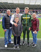 Academy youngster with Lee Trundle before the Premier League match between Swansea City and Manchester City at The Liberty Stadium in Swansea, Wales, UK. Saturday 24 September 2016