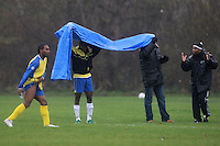 Players of Inter Lucia FC improvise a makeshift cover to keep the rain off during an East London Sunday League match at Hackney Marshes - 30/11/08 - MANDATORY CREDIT: Gavin Ellis/TGSPHOTO - Self billing applies where appropriate - Tel: 0845 094 6026