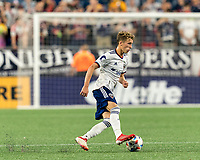 FOXBOROUGH, MA - AUGUST 18: Griffin Yow #22 of D.C. United dribbles at midfield during a game between D.C. United and New England Revolution at Gillette Stadium on August 18, 2021 in Foxborough, Massachusetts.