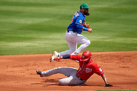 New York Mets shortstop Luis Guillorme (13) throws to first base over a sliding Juan Soto (22) during a Major League Spring Training game against the Washington Nationals on March 18, 2021 at Clover Park in St. Lucie, Florida.  (Mike Janes/Four Seam Images)