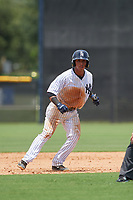 GCL Yankees West shortstop Oswald Peraza (24) leads off second base during a game against the GCL Pirates on July 25, 2017 at Pirate City in Bradenton, Florida.  GCL Yankees West defeated the GCL Pirates 11-3.  (Mike Janes/Four Seam Images)