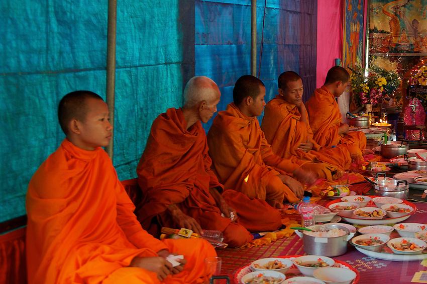 Near Aek Phnom Angkorian Temple, a local funeral ceremony in a Villiage near Battambang Cambodia,