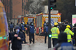 Police firefighters and health workers in Calle Toledo at the scene of an explosion in the center of Madrid, thought to have been caused by a gas leak. Around 3:00p.m in the afternoon, a strong explosion partially destroyed a building number 98 on Toledo Street, in the center of the Spanish capital. Preliminary reports point to a gas leak. January 20, 2021. (ALTERPHOTOS/Ricardo Blanco)