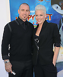 Carey Hart and Alecia Moore aka Pink  at The Warber Bros. Pictures'  World Premiere of HAPPY FEET TWO held at The Grauman's Chinese Theatre in Hollywood, California on November 13,2011                                                                               © 2011 Hollywood Press Agency