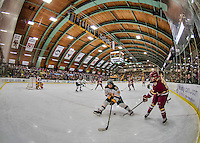 20 February 2016: Boston College Eagle Forward Matthew Gaudreau, a Junior from Carneys Point, NJ, passes the puck through the legs of University of Vermont Catamount Forward Jonathan Turk, a Senior from Calgary, Alberta, during the first period at Gutterson Fieldhouse in Burlington, Vermont. The Eagles defeated the Catamounts 4-1 in the second game of their weekend series. Mandatory Credit: Ed Wolfstein Photo *** RAW (NEF) Image File Available ***