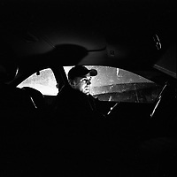 Tony Perlstein in his car at Global Docks as he waits to go on shift. He often ends up sleeping in his car. He is one of the dockers that stood for election on an anti-corruption ticket and was elected in 2007. The docks of New York and New Jersey have for generations been synonymous with organised crime, with the Genovese family in control of the New Jersey waterfront and the Gambinos in control of the New York side.