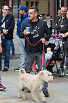 © Joel Goodman - 07973 332324 . 14/08/2016 . Manchester , UK . PAUL MASON arrives with a dog . A memorial on the site of The Peterloo Massacre ( formerly St Peter's Field , now the Manchester Central Convention Centre ) , attended by Maxine Peake and Paul Mason . On 16th August 1819 , a rally calling for Parliamentary reform , improved workers rights and against poverty was brutally suppressed by sabre-wielding cavalrymen , resulting in the deaths of fifteen people and many hundreds injured . Photo credit : Joel Goodman