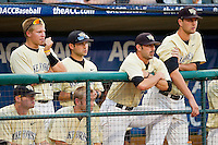 (L-R) Wake Forest Demon Deacons Jack Carey #20, Stephen Schoettmer #13, Grant Shambley #43, Gabe Feldman #24, Michael Dimock #23 and Justin Van Grouw #30 watch the action during the game against the Miami Hurricanes at NewBridge Bank Park on May 25, 2012 in Winston-Salem, North Carolina.  The Hurricanes defeated the Demon Deacons 6-3.  (Brian Westerholt/Four Seam Images)