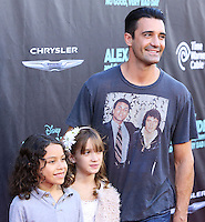 HOLLYWOOD, LOS ANGELES, CA, USA - OCTOBER 06: Gilles Marini, Juliana Marini arrive at the World Premiere Of Disney's 'Alexander And The Terrible, Horrible, No Good, Very Bad Day' held at the El Capitan Theatre on October 6, 2014 in Hollywood, Los Angeles, California, United States. (Photo by Xavier Collin/Celebrity Monitor)