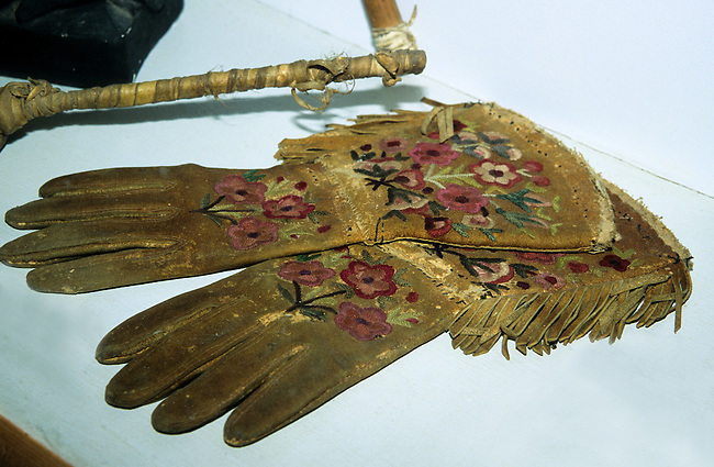 ca. 1886 pair of Algonquin, a Northeastern Woodland tribe, decorated their moose hide gloves. Indians decorated much of their clothing using colorful embroidery threads such as this floral design.