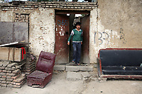 A resident leaves his home in a Uyghur community called 'Yamalik Hill', a poor area in central Urumqi, in China's western Xinjiang Province.