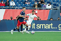 FOXBOROUGH, MA - MAY 1: Jeff Caldwell #25 of New England Revolution brings the ball forward under pressure from Jake Mulraney #23 of Atlanta United FC during a game between Atlanta United FC and New England Revolution at Gillette Stadium on May 1, 2021 in Foxborough, Massachusetts.