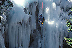 MAN ON ROPE CLIMBES ICE AT ICE FESTIVAL