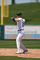 Detroit Tigers shortstop Gage Workman (27) throws to first base during a Minor League Spring Training game against the Baltimore Orioles on April 14, 2021 at Joker Marchant Stadium in Lakeland, Florida.  (Mike Janes/Four Seam Images)