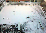 A private snow-plow driver begins the task of clearing a parking lot in downtown Milwaukee, Wis. (DOUG WOJCIK MEDIA)