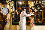 Pictured:  Volunteer Graham Martin, Chief Engineer, cleaning areas in the engine room of Southampton's Steamship Shieldhall as the team put Shieldhall to bed for the winter.<br /> <br /> The steamship marked her 65th birthday this summer, but was unable to celebrate as planned due to the pandemic. However, behind-the-scenes work on Shieldhall means that Southampton's heritage steamship is in excellent condition, with volunteers looking forward to a full 2021 sailing programme. <br /> <br /> Shieldhall last sailed in September 2019, and plans to sail again with passengers on board in May 2021. <br /> <br /> The ship provides a working example of steamship machinery both above and below deck, typical of the cargo and passenger ships that plied the oceans of the world from the 1870s until the mid 1960s, by which time they were all but extinct.<br /> <br /> Special trips held over from 2020 will be staged next year, including a cruise to celebrate the 200th anniversary of the first steamship to leave Southampton, the Prince of Cobourg, in 1820. <br /> <br /> Initially, a limited number of tickets will be available as Shieldhall introduces COVID-compliant measures on board during the autumn and winter. A Government Heritage Emergency Grant awarded during the summer has assisted Shieldhall's volunteers in carrying out essential maintenance works on the ship. <br /> <br /> © Simon Czapp/Solent News & Photo Agency<br /> UK +44 (0) 2380 458800