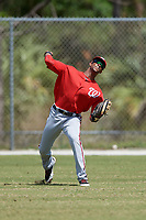 Washington Nationals Fernelys Sanchez (17) throws from the outfield during practice before a minor league Spring Training game against the St. Louis Cardinals on March 27, 2017 at the Roger Dean Stadium Complex in Jupiter, Florida.  (Mike Janes/Four Seam Images)