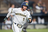 Michigan Wolverines shortstop Michael Brdar (9) rounds first base against the Central Michigan Chippewas on May 9, 2017 at Ray Fisher Stadium in Ann Arbor, Michigan. Michigan defeated Central Michigan 4-2. (Andrew Woolley/Four Seam Images)