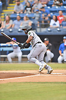 Augusta GreenJackets center fielder Heliot Ramos (14) swings at a pitch during a game against the Asheville Tourists on Crash Davis Night at McCormick Field on June 16, 2018 in Asheville, North Carolina. The GreenJackets defeated the Tourists 7-6. (Tony Farlow/Four Seam Images)