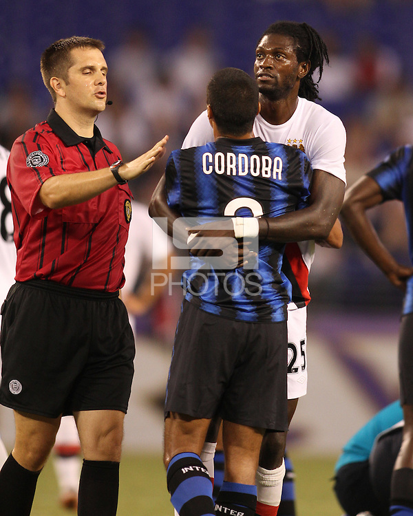 Ivan Cordoba #2 of Inter Milan is restrained by Emmanuel Adebayor #25 of Manchester City during an international friendly match on July 31 2010 at M&T Bank Stadium in Baltimore, Maryland. Milan won 3-0.