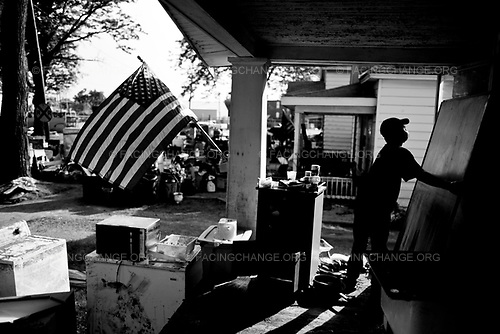Ceder Rapids, Iowa, <br /> USA<br /> June 2008<br /> <br /> A man cleans out his home. An estimated 35,000 people have been displaced by the floods and 24 have been killed in what the federal government describes as the biggest natural disaster since Hurricane Katrina.