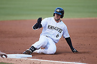Blake Rutherford (6) of the Charlotte Knights slides into third base after hitting a triple during the game against the Norfolk Tides at Truist Field on May 14, 2021 in Charlotte, North Carolina. (Brian Westerholt/Four Seam Images)