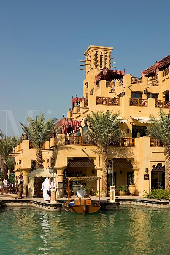 Dubai, United Arab Emirates. Madinat Jumeirah. Souk and water taxi boat, abra..