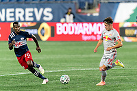 FOXBOROUGH, MA - AUGUST 29: Benjamin Mines #17 of New York Red Bulls dribbles at midfield during a game between New York Red Bulls and New England Revolution at Gillette Stadium on August 29, 2020 in Foxborough, Massachusetts.
