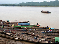 Street life in the town of Mrauk-U and surrounding areas, Rakhine State, Myanmar, Burma boats on the river bank of the Kaladan River,