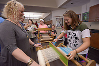 NWA Democrat-Gazette/BEN GOFF @NWABENGOFF<br /> Janelle Engle, president of the Northwest Arkansas Handweavers Guild, shows Katelyn Darden of Rogers how to use a rigid heddle loom on Sunday Oct. 2, 2016 duirng the annual Fall Festival at Hobbs State Park - Conservation Area near Rogers. The event featured a variety of family-friendly nature and old-time activities at the park's visitors center and Historic Van Winkle Hollow area.