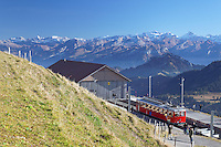 Red cog rail train car on summit of Mount Rigi, Switzerland, Europe
