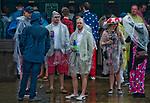 LOUISVILLE, KY - MAY 05: Fans crowd under the awning by the wagering windows to escape the downpour on Kentucky Derby Day at Churchill Downs on May 5, 2018 in Louisville, Kentucky. (Photo by Scott Serio/Eclipse Sportswire/Getty Images)