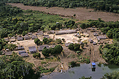 Koatinemo Amazon, Brazil. Aerial view of village, longhouse, river with boats, and airstrip.