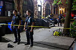 The NYPD investigates a shooting on Franklin Avenue near Park Place, where a woman was taken to the hospital in critical condition, in the Brooklyn borough of New York, U.S., on Wednesday, August 4, 2021. Photographer: Michael Nagle