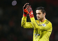 Swansea City goalkeeper Lukasz Fabianski thanks the fans at the end of the game during the Barclays Premier League match between Manchester United and Swansea City played at Old Trafford, Manchester on January 2nd 2016