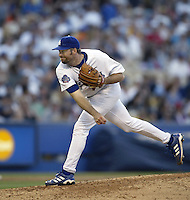 Paul Shuey of the Los Angeles Dodgers pitches during a 2002 MLB season game at Dodger Stadium, in Los Angeles, California. (Larry Goren/Four Seam Images)