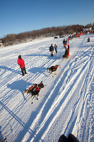 Jesse Klejka leaves the start line of the Junior Iditarod  at Knik Lake, Knik, Alaska