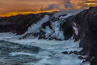 Steam rises when lava streams meet the ocean near Kalapana on the Big Island of Hawai'i.